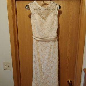 Cream colored lace wedding dress.